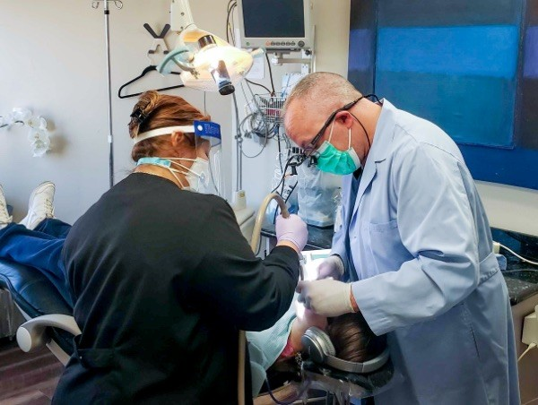 Doctor Brumbaugh and dental team member treating dentistry patient