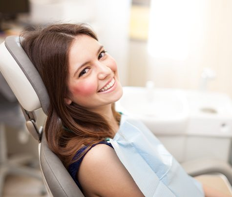 Woman sharing healthy smile after preventive dentistry