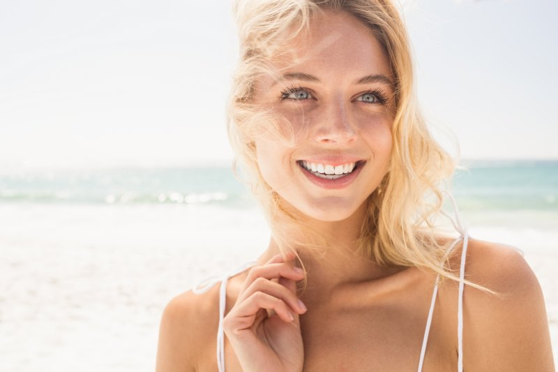 Woman smiling after receiving cosmetic dentistry in Park Cities, Dallas